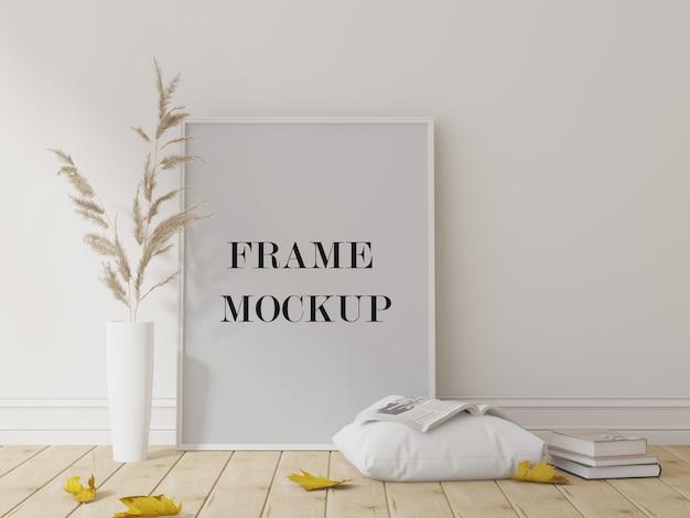 Maquette de cadre photo blanc à côté de plantes sèches et de feuilles