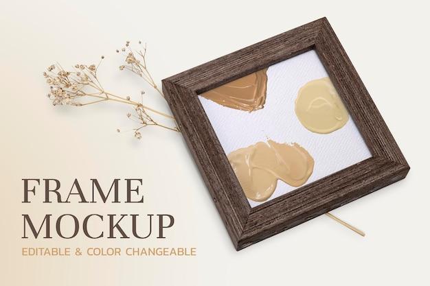Maquette de cadre photo en bois psd avec fleur séchée esthétique