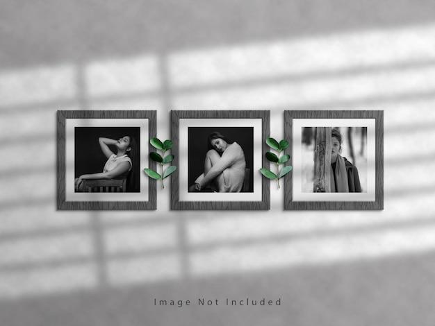 Maquette de cadre photo carré sur mur blanc et superposition d'ombres