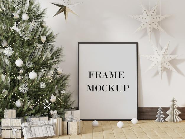 Maquette de cadre photo à côté de l'arbre de noël