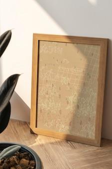 Maquette de cadre photo en ton marron avec plante