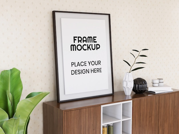 Maquette de cadre photo vierge sur le bureau