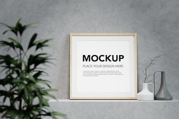 Maquette de cadre photo vierge sur étagère en béton