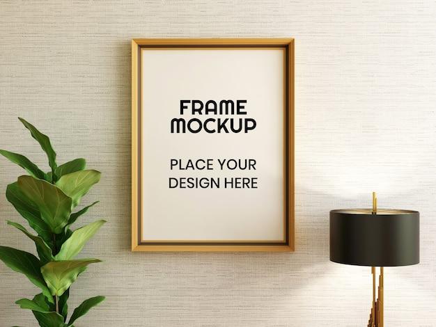 Maquette de cadre photo vierge avec plante et lampe