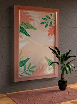 Maquette cadre rose minimaliste accrochée au mur