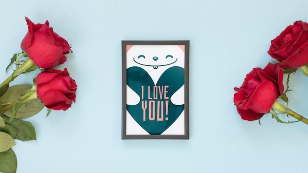 Maquette de cadre avec des roses pour la saint valentin