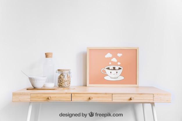 Maquette de cadre sur la table en bois