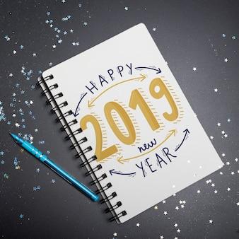 Maquette de cahier avec concept de nouvel an