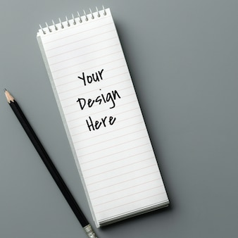 Maquette de cahier et un crayon