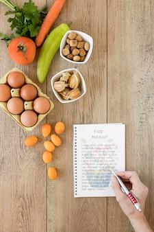 Maquette de cahier et ingrédients