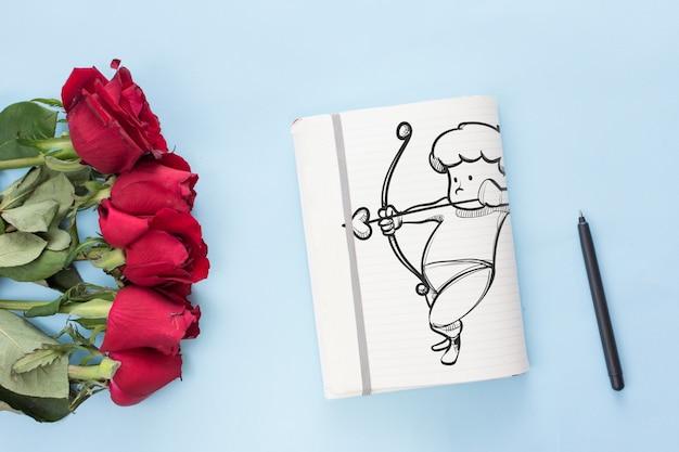 Maquette de cahier avec des roses pour la saint valentin