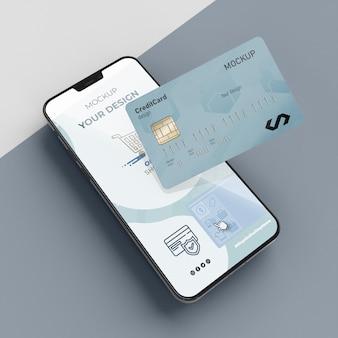 Maquette de carte de crédit avec mobile