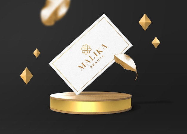 Maquette de carte de visite de luxe avec ornement doré et scène de présentation ronde en bois or