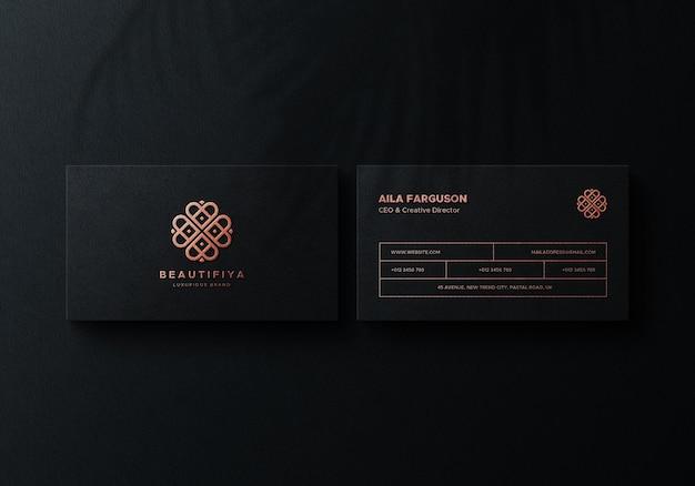 Maquette de carte de visite noire avec impression métallisée