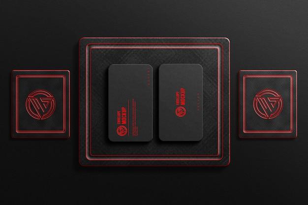 Maquette de carte de visite sombre avec des logos au néon rouge