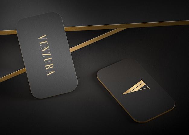 Maquette de carte de visite typographique moderne en or noir de luxe pour le rendu 3d de l'identité de la marque