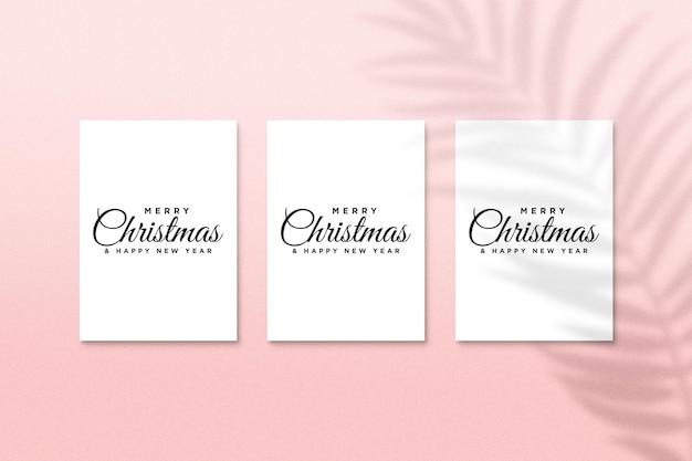 Maquette de conception de carte de voeux de vacances de noël psd avec ombre de feuilles de palmier