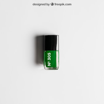 Maquette cosmétique avec vernis à ongles vert