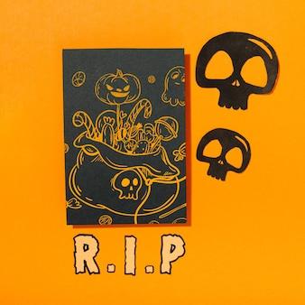 Maquette de couverture d'halloween noire avec des crânes