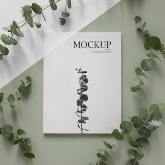 Maquette de couverture de magazine nature à plat avec arrangement de feuilles