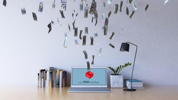 Maquette de design d'intérieur avec de l'argent volant dans l'ordinateur portable