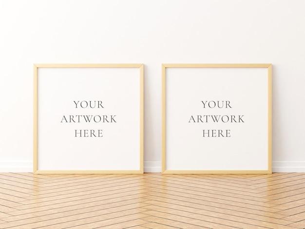 Maquette de deux cadres en bois carrés sur le plancher en bois. rendu 3d.
