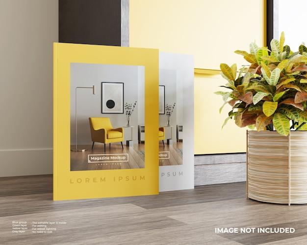 Maquette de deux magazines sur plancher de bois avec placard et usine