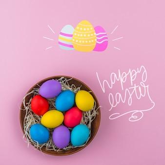Maquette du jour de pâques avec un nid d'œufs colorés