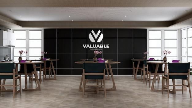 Maquette du logo de l'entreprise dans le mur de la cuisine du bureau