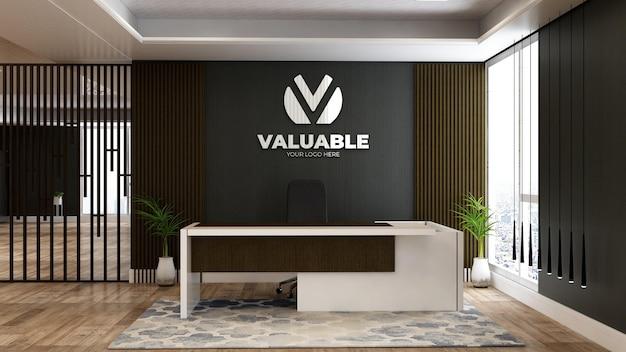 Maquette du logo de l'entreprise dans la réceptionniste du bureau ou dans la salle de réception