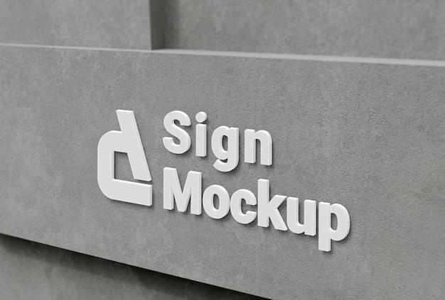 Maquette du logo de l'entreprise sur la façade en béton