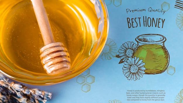 Maquette du miel délicieux sur un bol