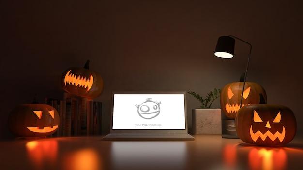 Maquette d'écran d'ordinateur portable avec image de rendu 3d de table de travail avec tête de citrouille
