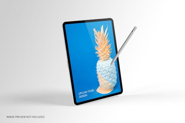 Maquette d'écran de tablette debout avec un crayon