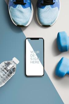 Maquette d'écran de téléphone portable et équipement sportif