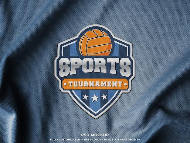 Maquette d'écusson de logo de broderie sur le tissu de maillot de sport