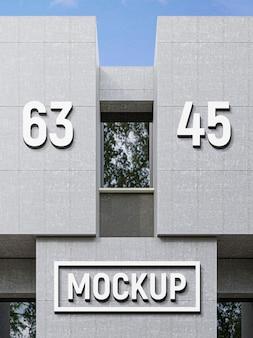 Maquette d'effet de logo de façade en béton