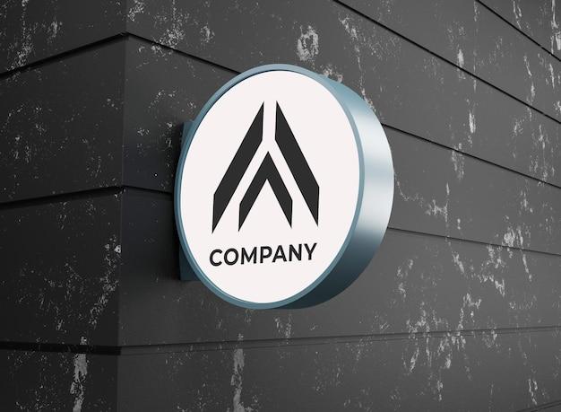 Maquette d'entreprise de logo avec panneau de signalisation sur le mur