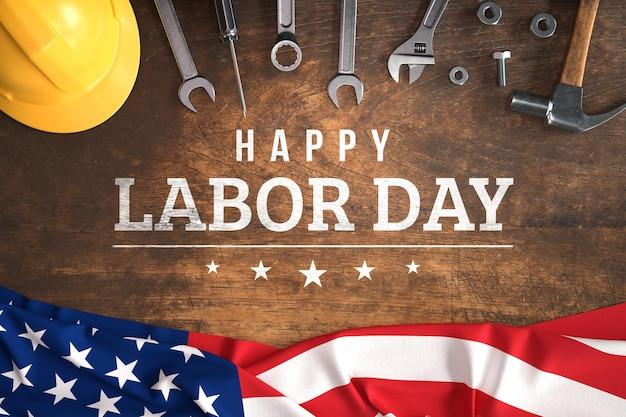 Maquette de la fête du travail avec outils à main et drapeau américain