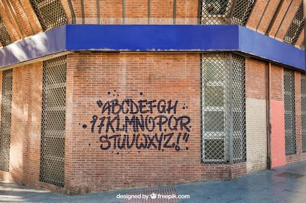 Maquette de graffiti sur le mur de briques