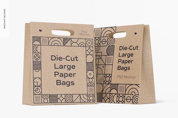 Maquette de grands sacs en papier découpés à l'emporte-pièce