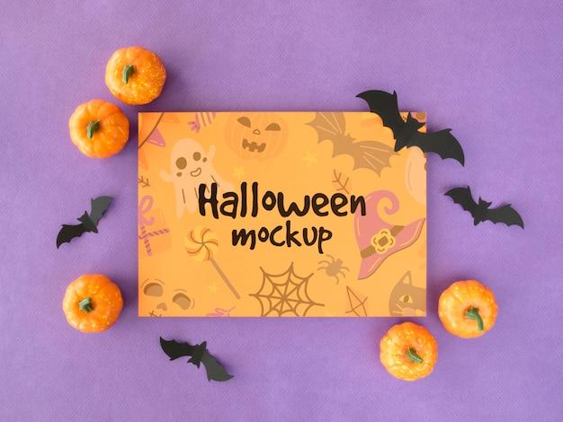 Maquette d'halloween avec des chauves-souris et des citrouilles
