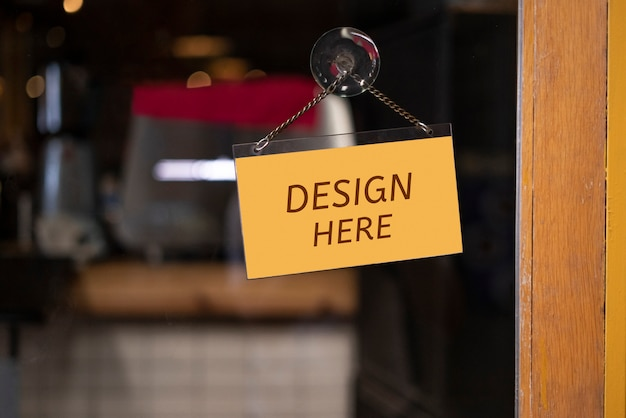 Maquette ici signe devant un restaurant, magasin, bureau ou autre