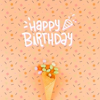 Maquette de joyeux anniversaire et cornet de crème glacée