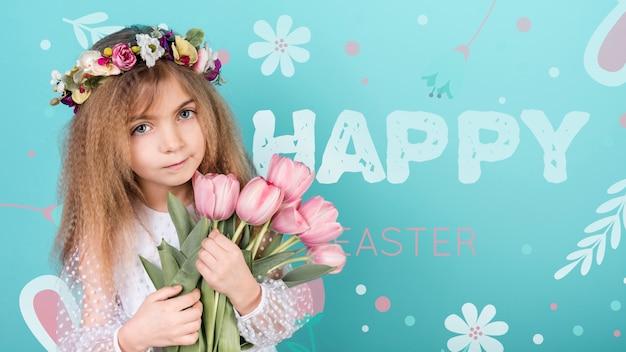 Maquette de joyeux jour de pâques avec fille et fleurs