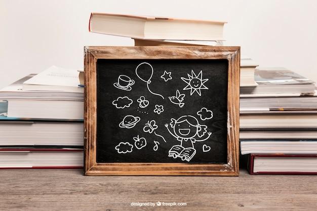 Maquette de livre avec ardoise penchée