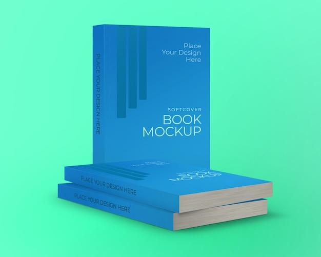 Maquette de livre à couverture souple deux piles de livres et un debout derrière isolé sur fond vert