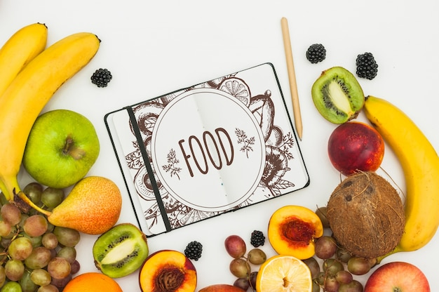 Maquette livre ouvert avec des fruits
