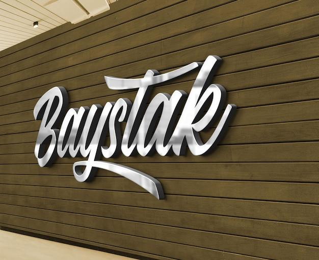 Maquette de logo argenté 3d avec un mur en bois