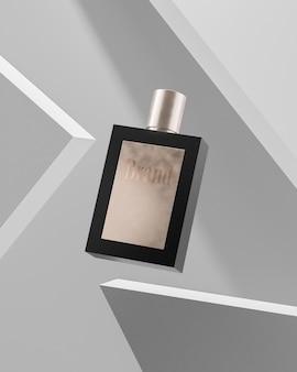 Maquette de logo de bouteille de parfum noir